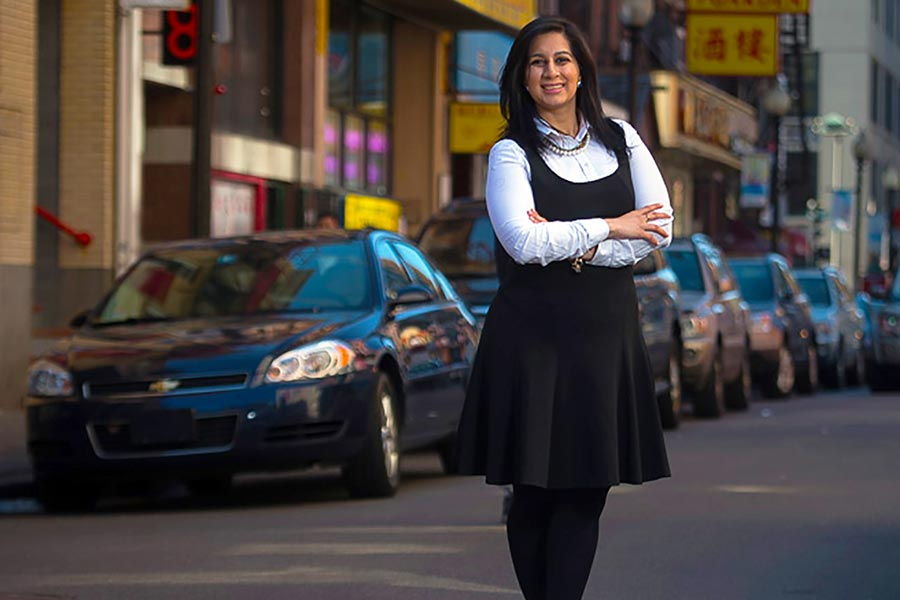 A recent graduate of New England Law | Boston after completing her immigration law  school degree.